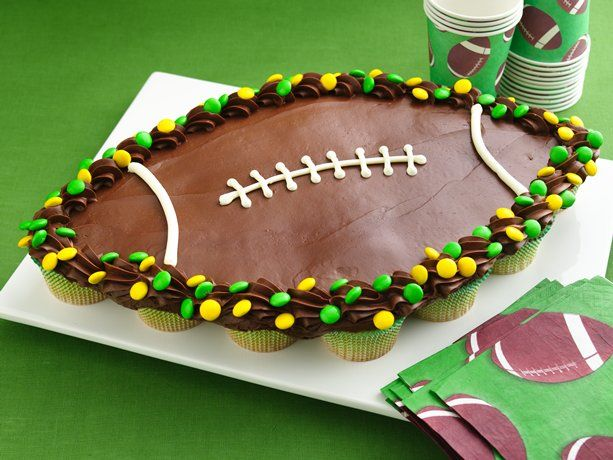 Football Cupcake Pull-Aparts....someone today who used to make cakes for a catering company  and she said that they would pipe icing in the gaps between the cupcakes before frosting the whole thing to prevent the sink holes or gaps in the frosting. So that's what I'll try!