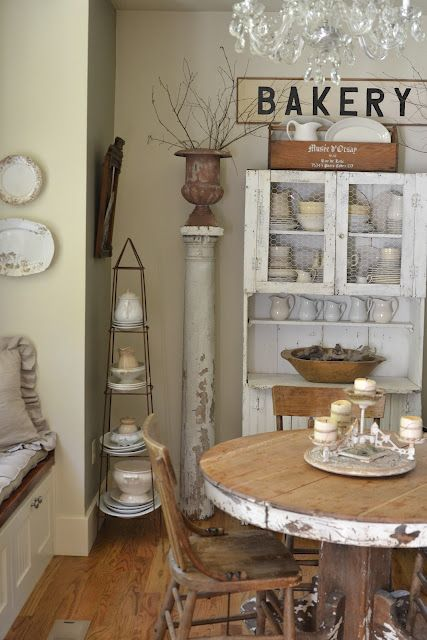 Faded Charm: bakery sign, chicken wire in cupboard, ironstone, chippy table, trellis - so much to love!
