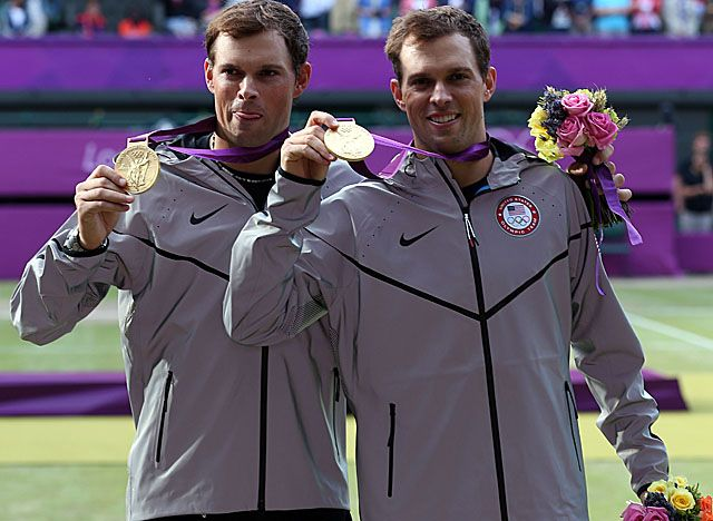 Mike (left) and Bob Bryan, three-time Olympians who won bronze in 2008, take gold in London. (Getty Images)	   WIMBLEDON, England -- In his final feat of athleticism at the Olympics, Bob Bryan caught his brother.    Mike Bryan leaped into his twin's arms after they completed a career Golden Slam by winning the gold medal in doubles Saturday, beating Jo-Wilfried Tsonga and Michael Llodra of France 6-4, 7-6 (2).
