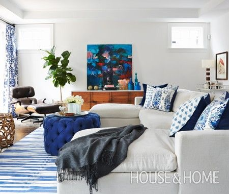 Playful Family Room | Designer Robyn Madeline | Photographer Virginia Macdonald | #houseandhome #livingroom #blueandwhite #sectionalsofa #pillows #ottoman