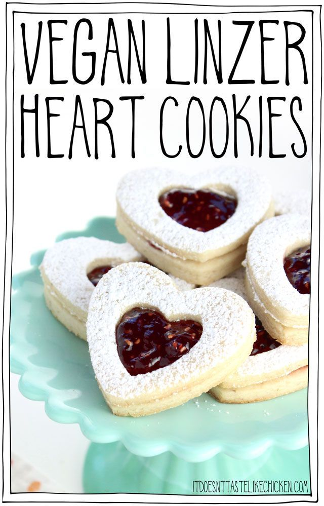 Vegan Linzer Heart Cookies! The buttery soft sugar cookie, sprinkled with powdered sugar, filled with sweet raspberry jam. They are every bit as tasty as they are adorable. Perfect for a gift for a loved one on Valentine's day or other special occasions. Egg-free, dairy-free. #itdoesnttastelikechicken #valentinesday #veganvalentines #veganbaking via @bonappetegan
