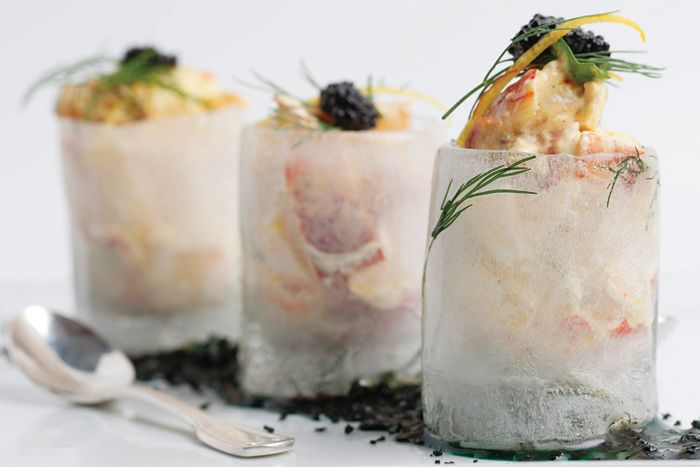Another hors d'oeuvre idea: Chilled lobster salad with Pernod aioli, topped with Russian osetra caviar and Kiev lemon crème fraiche served in dill-infused ice cups.