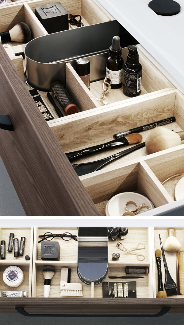 Open the drawer and find exclusive solid oak trays designed to organise everything from jewellery to cotton pads.