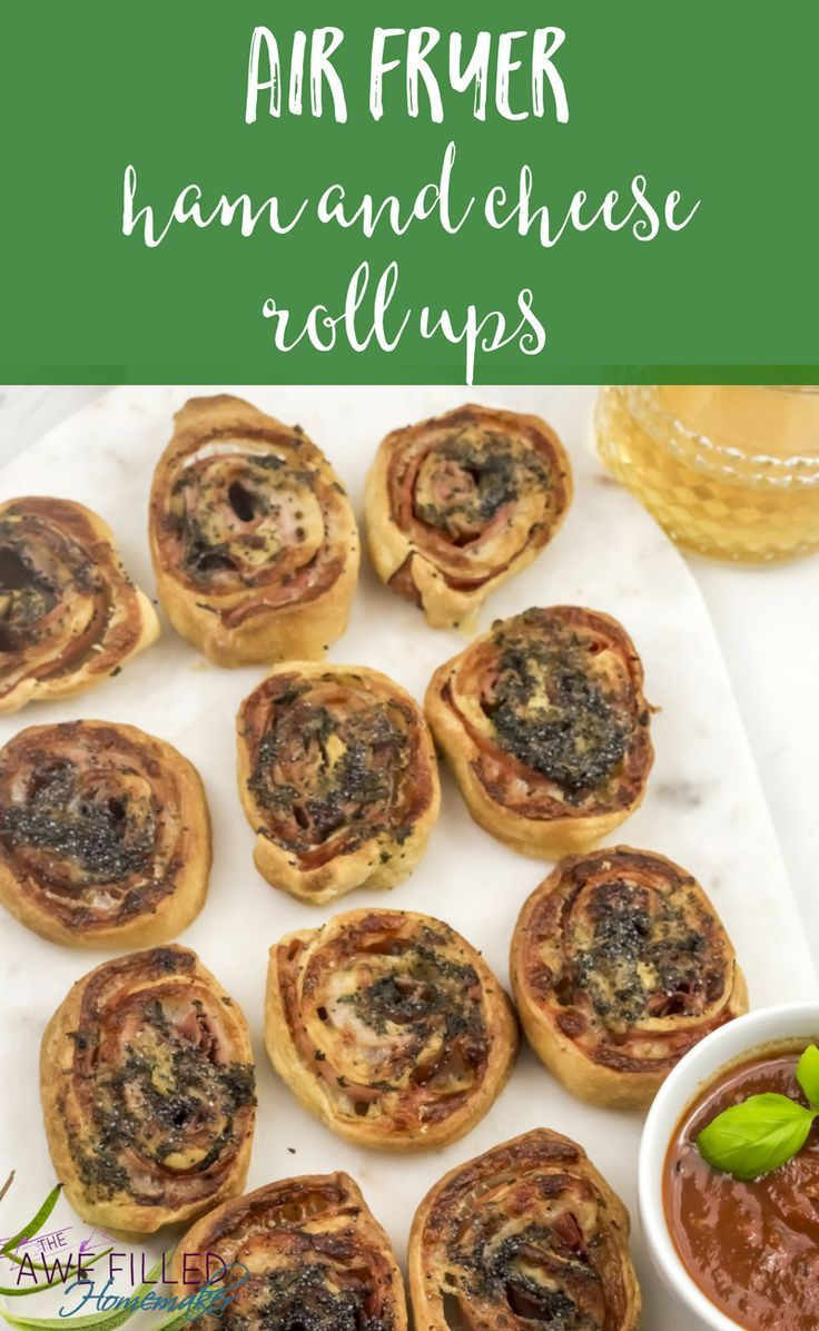 Looking for a delicious recipe for your New Years party, birthday party, or just for a snack? These Air Fryer Ham & Cheese Roll Ups are so good! #airfryer #appetizer #partyfood #ham #snacks via @AFHomemaker