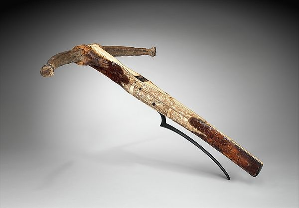 Crossbow of Matthias Corvinus, King of Hungary (reigned 1458–1490)   Date: dated 1489  Geography: possibly Vienna  Culture: Central or Eastern European, possibly Vienna  Medium: Wood, horn, animal sinew, staghorn, birch bark, iron alloy  Dimensions: L. 29 in. (73.7 cm); W. 24 in. (60.9 cm); Wt. 5 lb. 1/2 oz. (2284 g)  Classification: Archery Equipment-Crossbows