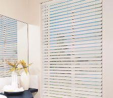 Synthetic wood venetians are ideal for bathroom areas where humidity is a problem.
