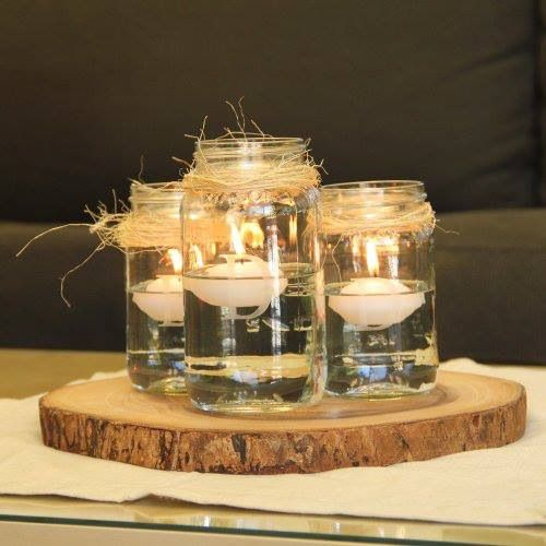 Really like this for a winter wedding centerpiece - makes me think I'm sitting by the fireplace..:)