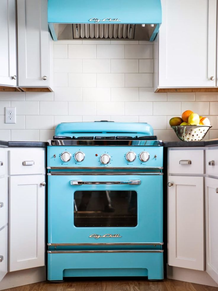 In the market for new kitchen appliances? Bored with the same old color and finish choices? Have you thought about the bold choice of adding color to your kitchen appliances?! It's now easier than ever! This range from Big Chill makes an unavoidable statement in this classic white kitchen.