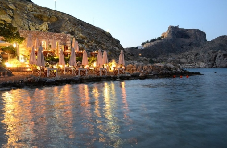 The 'Tambakio' restaurant and beach bar is in the picturesque bay, known as 'St Paul's bay.' Being close to the location for the ceremonies held at St Paul's chapel, it is perfect for those wanting a reception venue with a view of the sparking sea of the bay, incorporating the chapel, where they were married, and the beautiful 'Acropolis' high in the background.This restaurant is located just a stones throw from the water & on the sand, so a really unique venue to eat at!