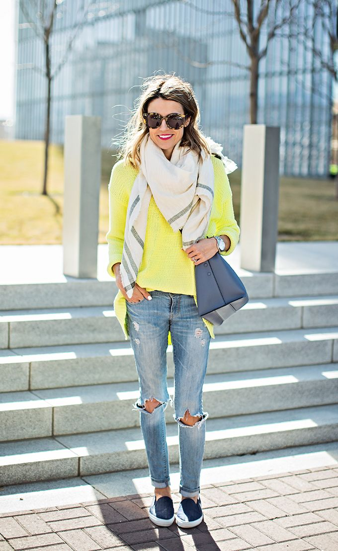 neon sweater and ripped jeans