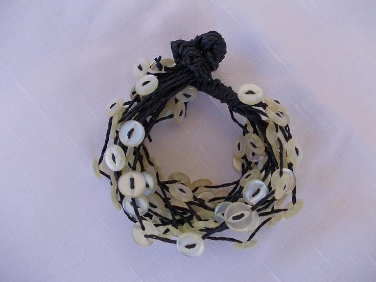 Bracelet with ivory buttons.via Etsy.