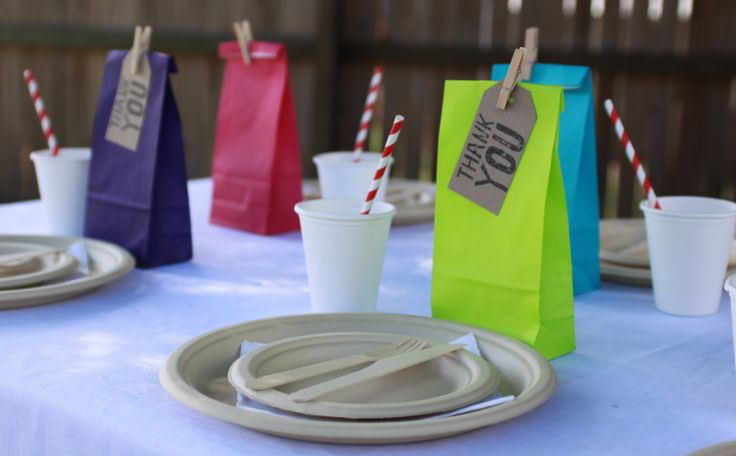 Super cute Eco Party idea.Colourful bags, sugar cane tableware, wooden cutlery, striped straws and brown Kraft thank you tags. All supplies from Quality Time Party Supplies.