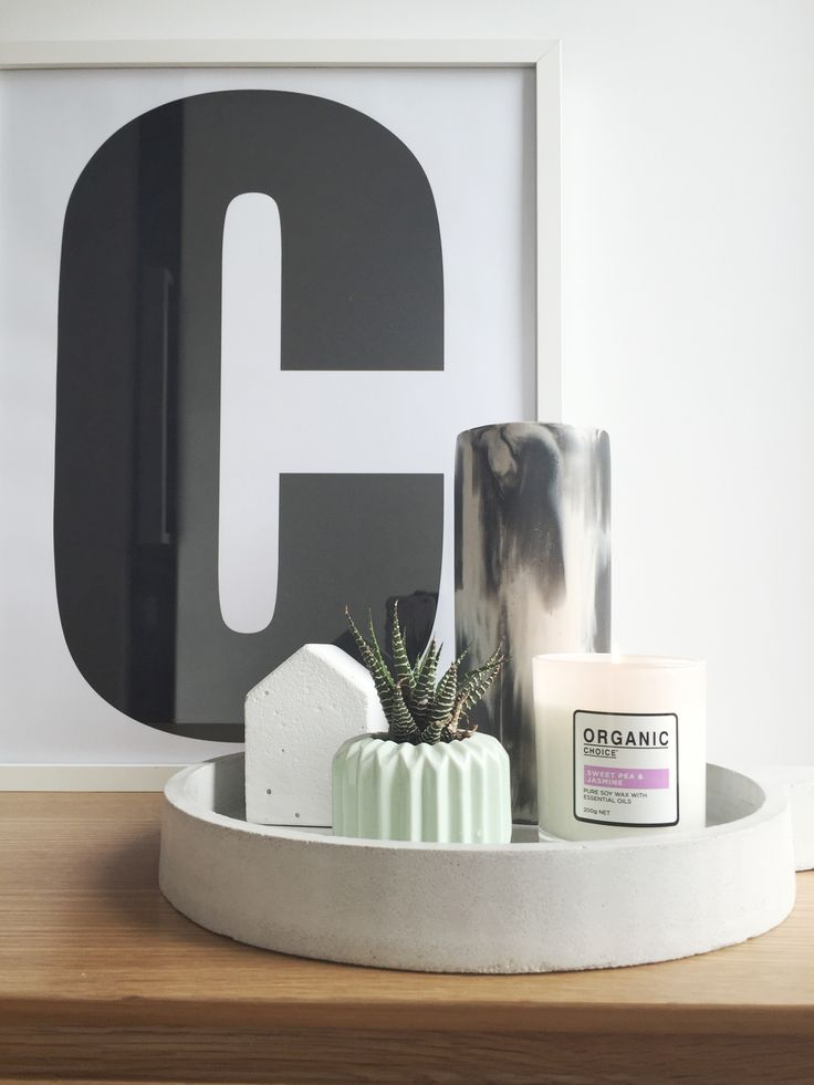 Shelf styling with mainly monochrome palette. C print, concrete house and concrete tray are some favourite pieces to style with.
