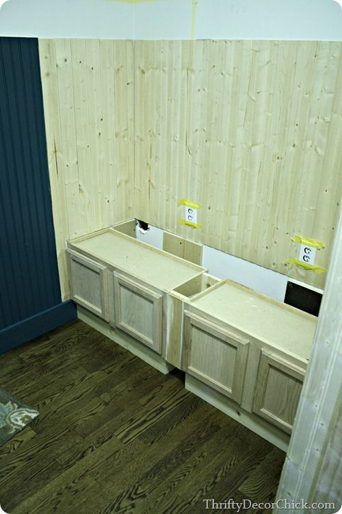 building a mud room bench with kitchen cabinets so