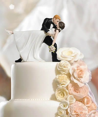 This wedding couple is wrapped in a romantic embrace of dance. The Bride's pretty pony tail, simple dress and rhinestone shoes give this wedding cake top a lovely modernized twist on a classic pose. Hand painted porcelain.