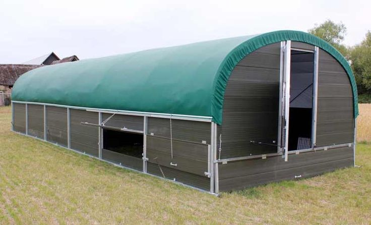 External view of 500 bird laying house demonstrating the pop-holes and pvc outer layer.