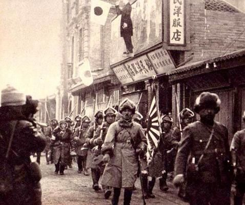 Japanese troops enter a Chinese city after the Mukden incident. September or October, 1931.