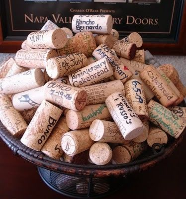 Guestbook alternative- I have been collecting corks as event souvenirs since 1990. Its a walk down memory lane everytime I pass my display of special ones ( an old typesetters drawer) it hangs on my dining room wall! I am almost done with my DRAPE of corks...yes a drape. Will post pics when done!