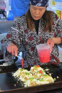 Food vendor making Okonomiyaki at the International Summer Night Market in Richmond, BC. www.summernightmarket.com