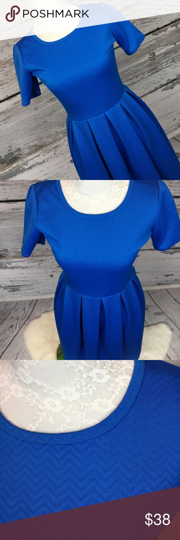 "•Lularoe• Amelia RARE Blue Chevron Dress Sz XS GORGEOUS Lularoe Amelia RARE Textured/Embossed Chevron Royal Blue Dress. Size XS. Side pockets. Zippered back. Excellent condition from a smoke free home!!  Approximate measurements (flat): Armpit to armpit: 16"" Armpit to bottom: 30.5"" Shoulder to bottom: 38"" At waist: 13"" (unstretched) LuLaRoe Dresses"