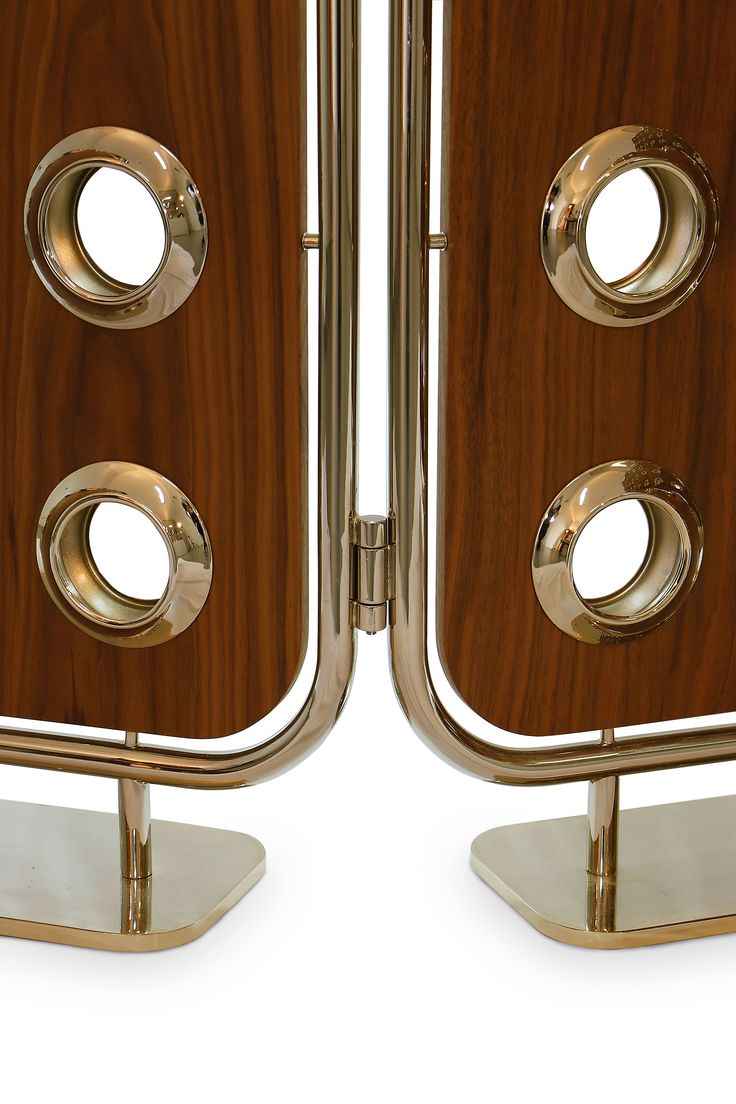 Monocles screen is a refined 3-panel room divider. Produced in solid walnut wood, it is accentuated by a polished brass frame and brass holes that let you glimpse into the other side. The mix between the materials give a warm and natural look to your office, living room or bedroom decor. Stylish like no other.