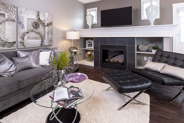 The great room is perfect for visiting, and the tile around the fireplace is…