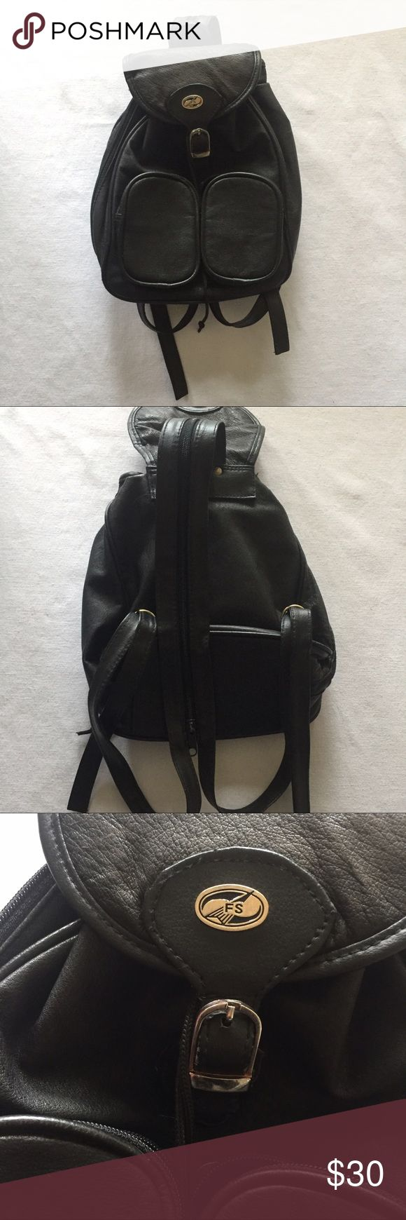 Leather Mini Backpack Purse Real leather backpack Purse is of unknown brand and is pre-loved but in good condition. Top flap has slight discoloration from either sun or water, but is not that noticeable. Has so many pockets and zippers and would be perfect for carrying all your things to summer festivals! Bags Backpacks