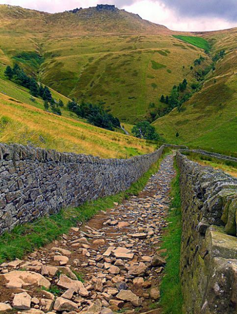 """One of the best walks in the Derbyshire Peak District of England is Jacob's Ladder; an old pack horse route with a short steep climb leading to a magnificent view of the vale (valley) of Edale. It is bounded to the north by Kinder Scout, a plateau described as being 'full of strange stones and goughs'   A gough, is a channel or fissure in a peat moor; also known as a peat hag."""