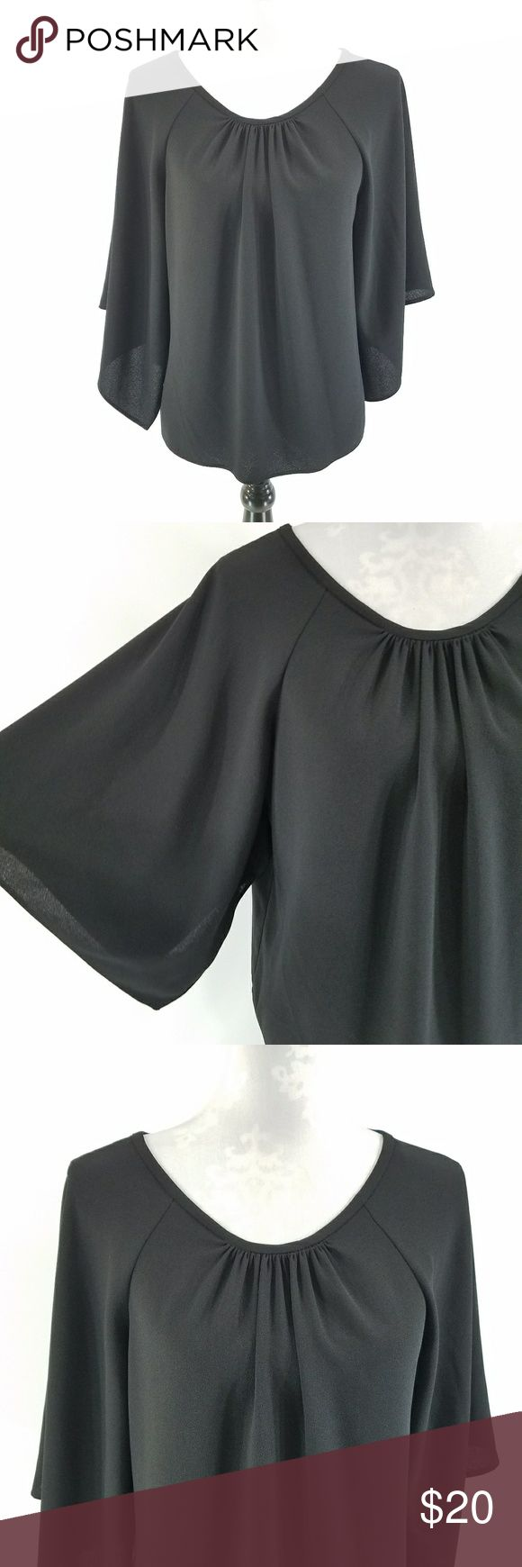 "Zara Black Batwing Top Women's Zara Top  No Material Tag  Size Large  Gently Used EUC   Measurements Laying Flat:  Underarm to Underarm: 22""  Length: 25.5"" Zara Tops"
