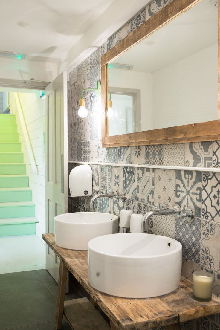 Hally's Parsons Green bath, love the walls, sinks, and green stairs!