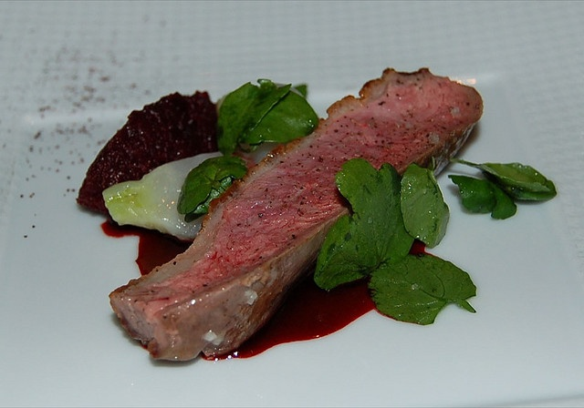 """The French Laundry """"Aiguillette"""" of Liberty Valley duck breast, slow baked red beet """"tapenade"""", glazed Tokyo turnips, watercress leaves and red beet emulsion"""
