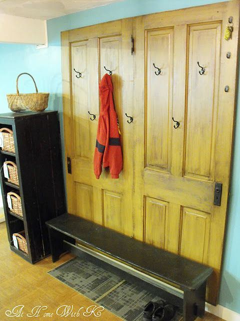 Cool mudroom or hallway idea - secure old doors to the wall and put hooks on them. I'd like the doors painted, though.