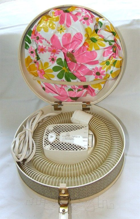 Hairdrying 1960s style - I remember sitting with the plastic bonnet on and you couldn't hear anything, lol!