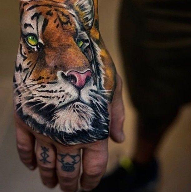 realistic tiger hand tattoo idea