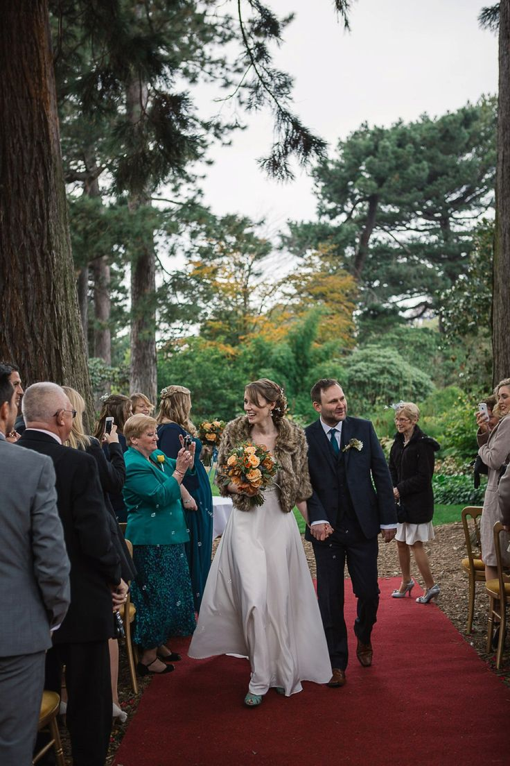 Bride Wears A Faux Fur Shrug For Her Outdoor Autumn Wedding In Scotland Photography By