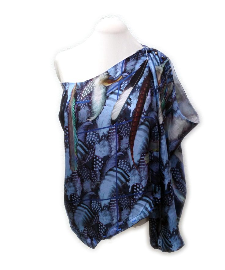 As you may see in other pictures, it is actually a silk scarf, but you can also wear it as a beautiful top!