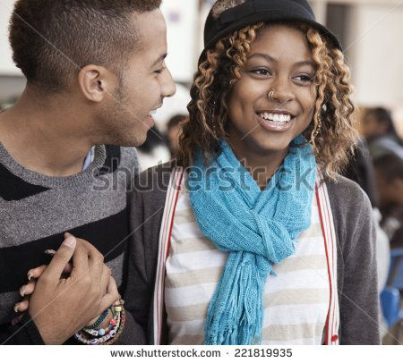 Students holding hands in classroom - stock photo