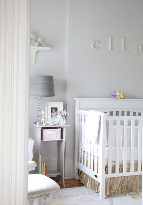Adorable nursery. Love the crib, name on the wall, and paint color