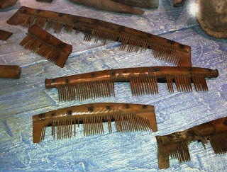 Jorvik Centre:  Bone and antler combs found in the Coppergate area of York.  These were really common objects, however, the evidence points to a crafter making combs at Coppergate as many half-finished combs were found.  The teeth were finely spaced so as to take care of nits and lice.  Larger picture at source.