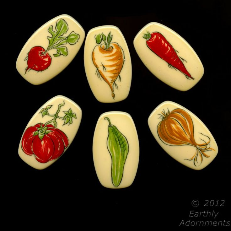 Set of 6 retro acrylic pendants with a different veggie on each.  Cucumber, carrot, bell pepper, turnip, garlic and radish.  All of the antioxidents you need and they don't need refrigeration.  Just think of the possibilities:  refrigerator magnets, fringe necklaces, earrings, garden charms, wind chimes, or napkin holders to match your garden tablecloth.  Let your creativity sprout.    50x30mm, flat back with set in bail, West Germany.  Get 'em while they're fresh!
