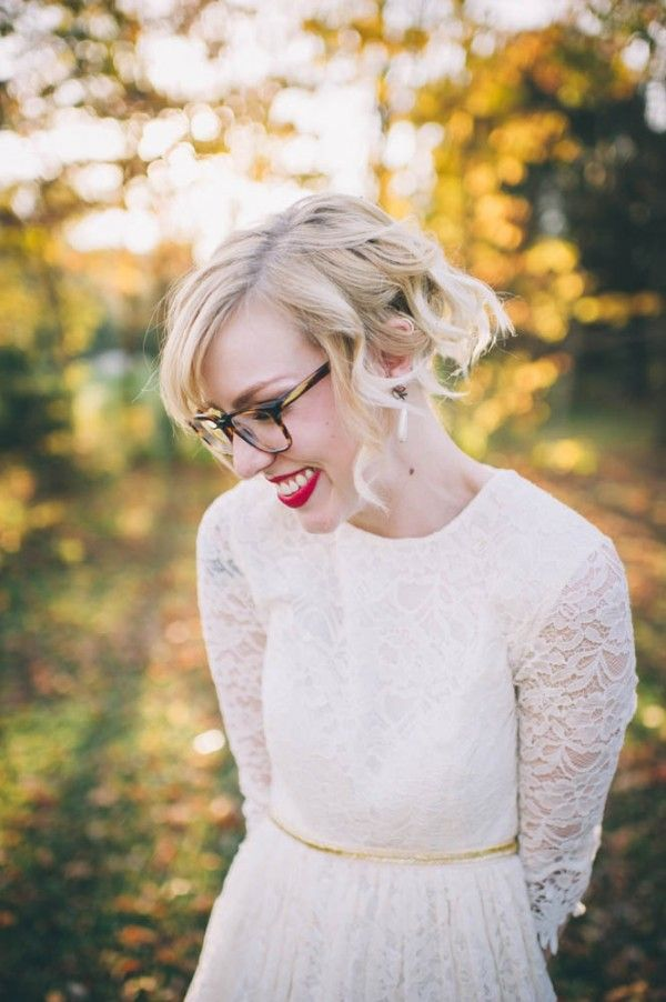 this bride is adorable! love her sweet long sleeved lace wedding dress!