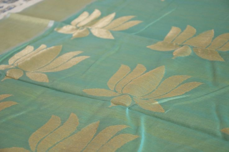 Aquamarine handwoven silk-cotton Chanderi saree with lotus motifs, hand-picked from weavers by Omnah.