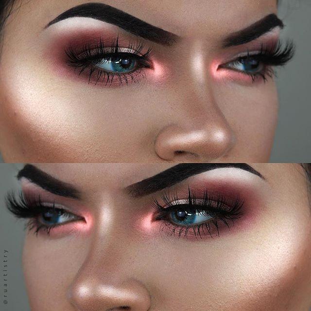 Love this glowy make up look. Neon pink highlight and purple smokey eye.