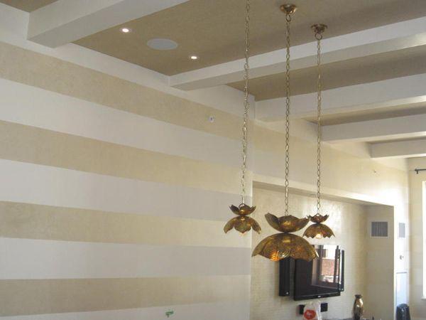 sara gilbane | Gold striped walls by Sara Gilbane Interiors