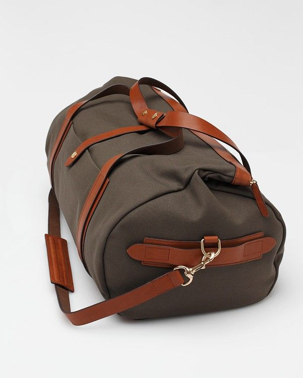 Explorer Canvas Duffle Bag by Mismo  This bag will make you look like a million dollars while only costing you a very small percentage of that.It's of a water-resistant canvas, with quality construction and refined details, including full grain leather panels and trim. Get it here.