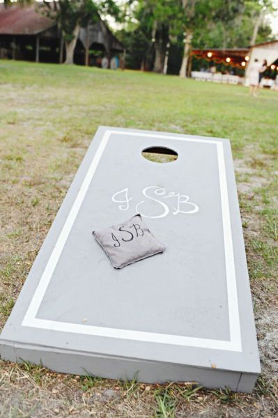 "lots of cute custom ideas : monograms, ""his & hers"" ""Mr. & Mrs"" neutral color wood with bright bean bags"