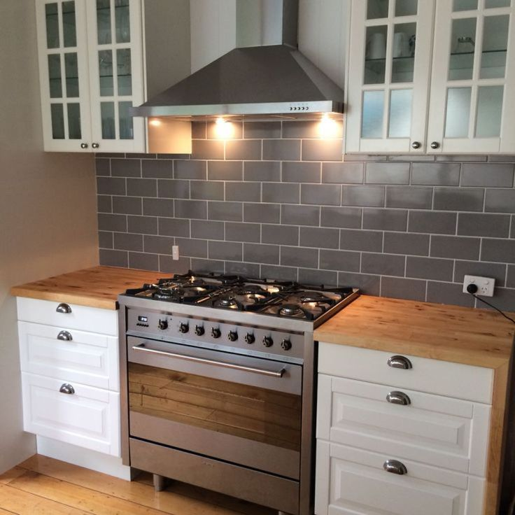 Kitchen With Subway Tile Backsplash And Freestanding Oven