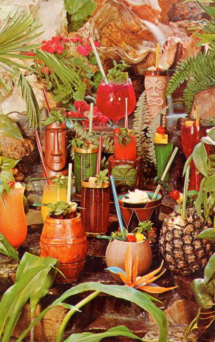 Everything about this is perfect: from the colorful drinks to the pineapples and tropical plants and tikis, right down to the great overly-red photography. #tikidrinks, #jungleshots, #tikis