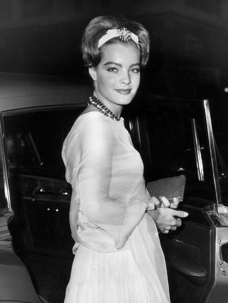 Romy Schneider - Romy Schneider  Actress Romy Schneider smiles as she stands by an automobile at the American benefit premiere of the film, 'Boccaccio '70.' She is wearing a creation by Chanel and photographed by Hulton. NY,June 1962.