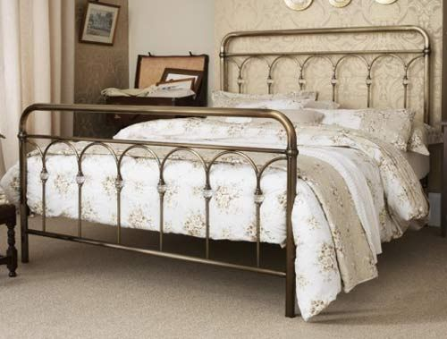 The Shilton bed frame features a striking vintage-inspired design with subtle detailed elements. Available in antique brass or antique nickel.